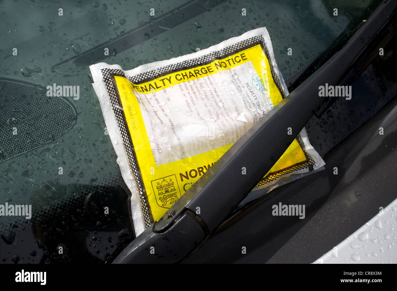 Car Parking Penalty Charge Notice on Car Windscreen - Stock Image