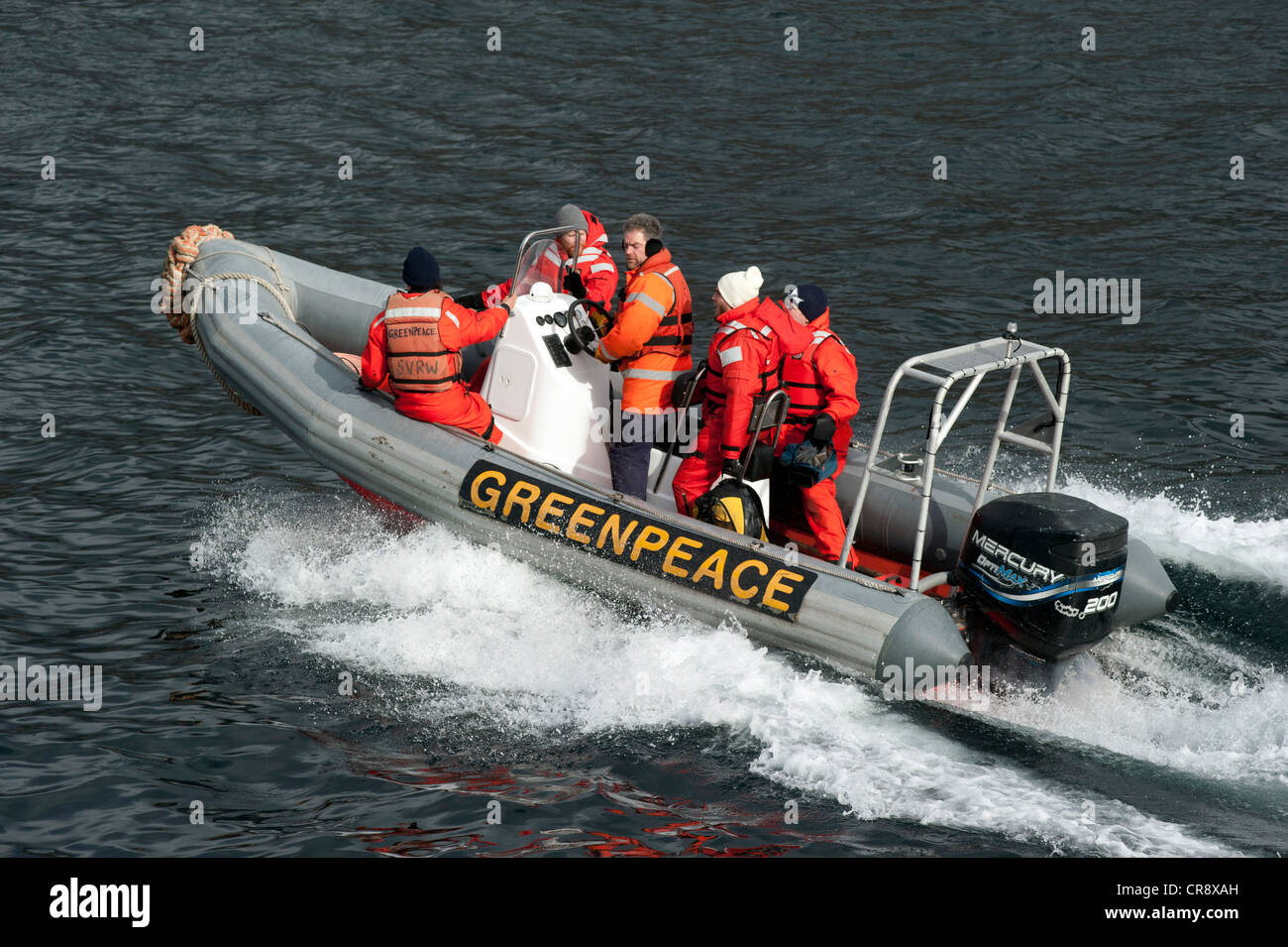 Greenpeace activists in an inflatable boat - Stock Image