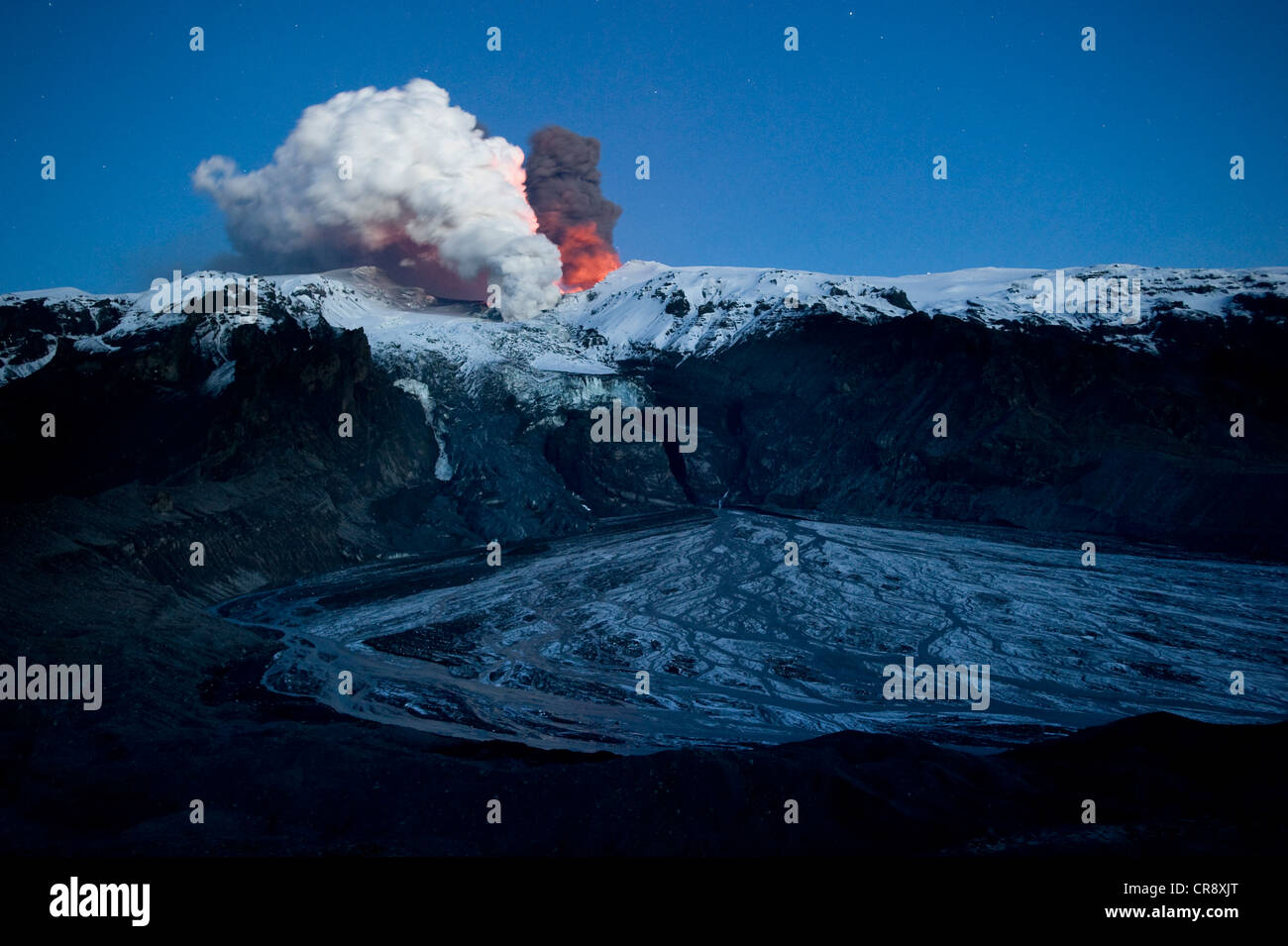 Ash cloud of the Eyjafjallajoekull volcano, steam plume from the lava flow in Gigjoekull glacier tongue, and exit - Stock Image