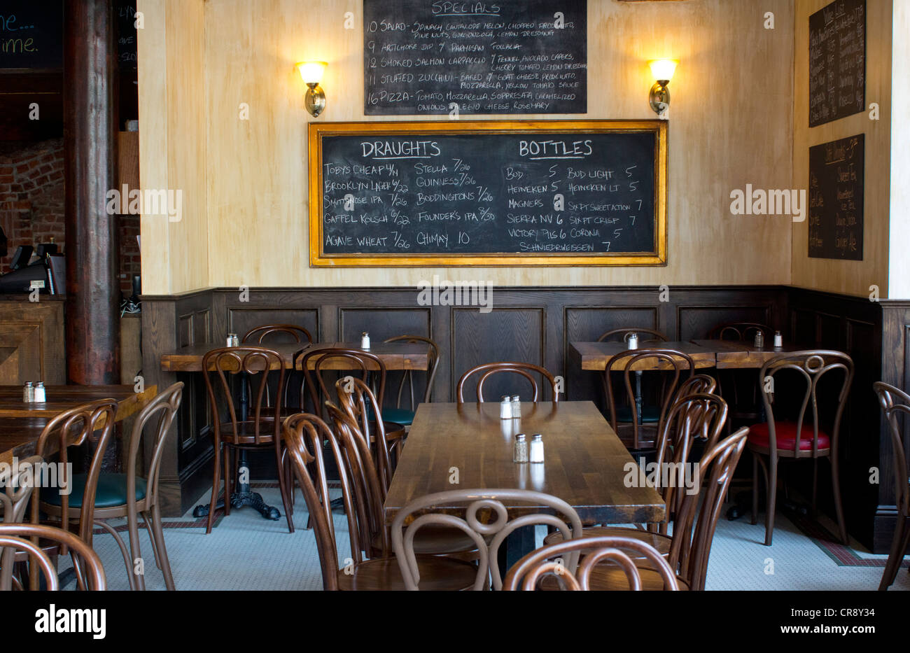 An empty bar restaurant and pizzeria with chalk-written menu in Little Italy in Lower Manhattan, New York City - Stock Image