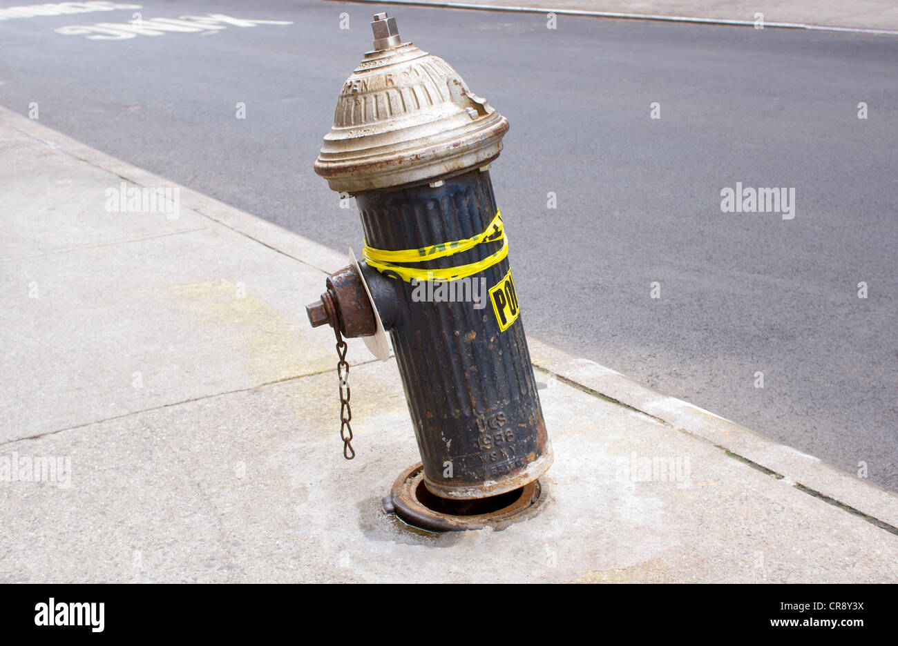 An old out of order broken fire hydrant  in New York City - Stock Image