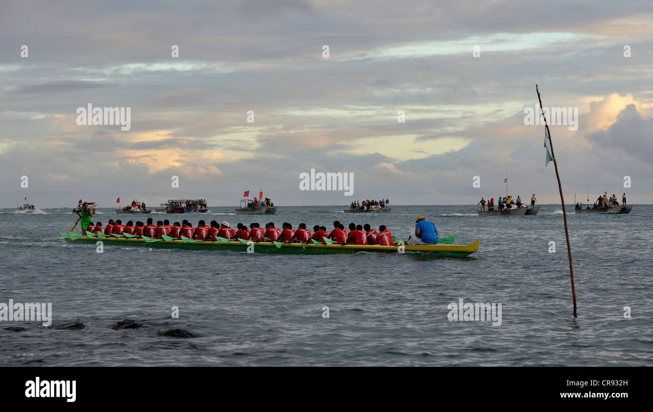 Fautasi Race Finals and the winning Dom Bosco college boat, Segavao Digicell 3 leads the field back to Apia Harbour, - Stock Image