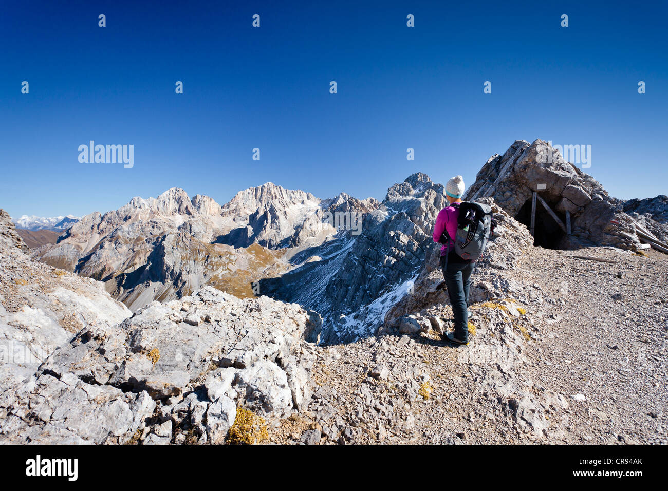 Hiker on Bepi Zac climbing route in the San Pellegrino Valley above the San Pellegrino Pass, currently on Costabela Stock Photo