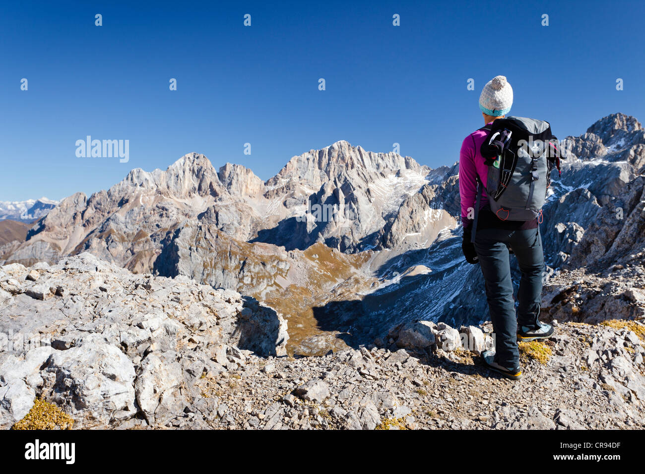 Hiker on Costabella Mountain while ascending the Bepi Zac Climbing Route in the San Pellegrino Valley above the Stock Photo