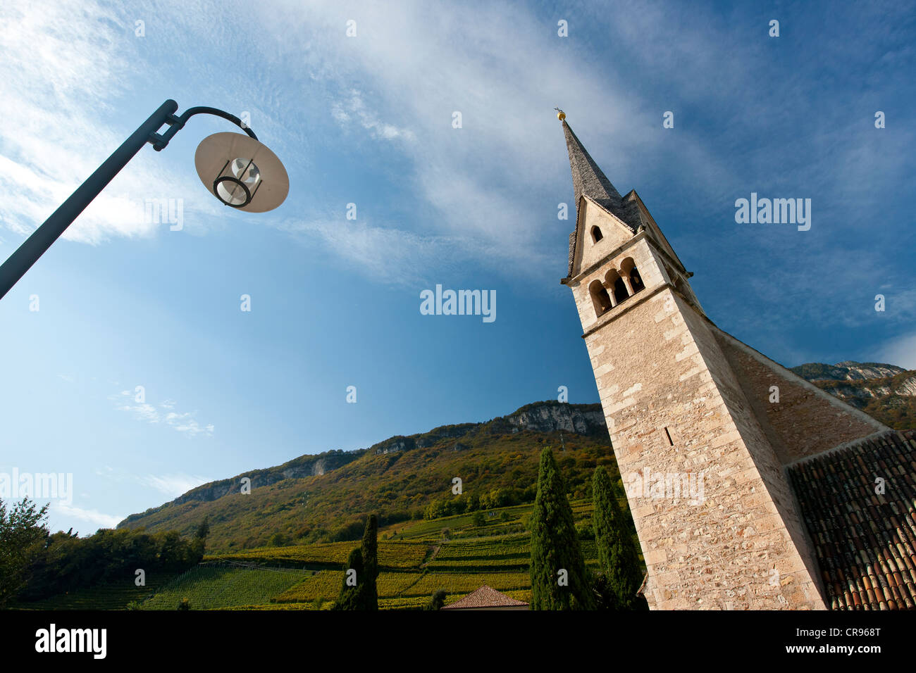 Steeple of the church of St. Valentine in Tramin, South Tyrol, Italy, Europe - Stock Image