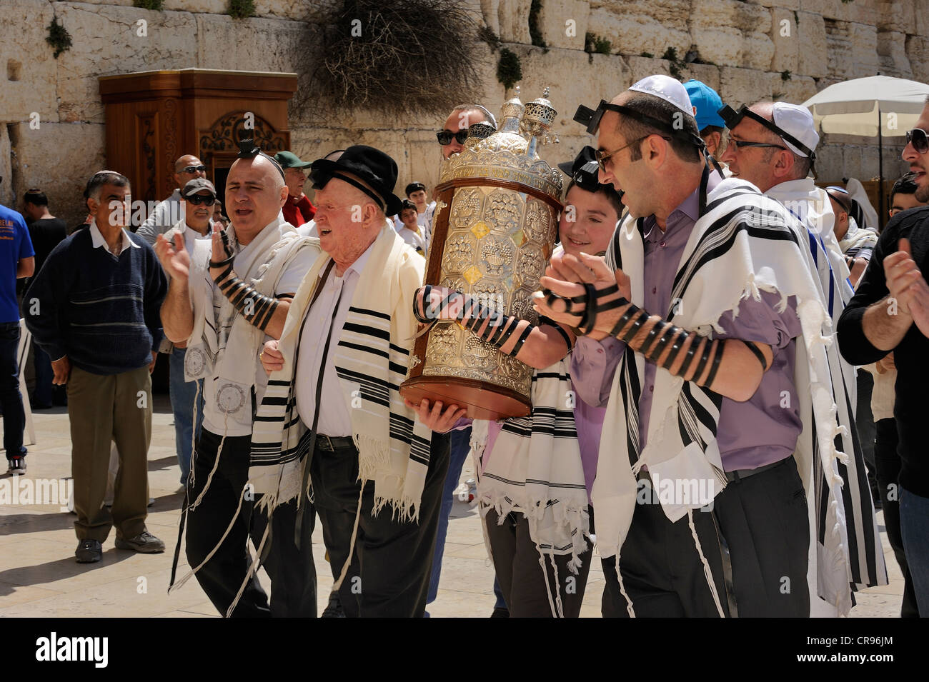 Bar Mitzvah celebration at the Western or Wailing Wall in the direction of the Jewish Quarter, boy is carrying the - Stock Image