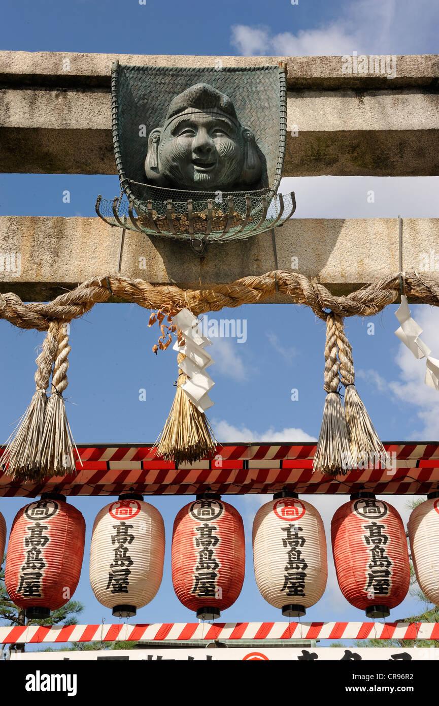 Torii gate with mask and money basket for donations, Ebisu Shrine, Gion, Kyoto, Japan, Asia - Stock Image