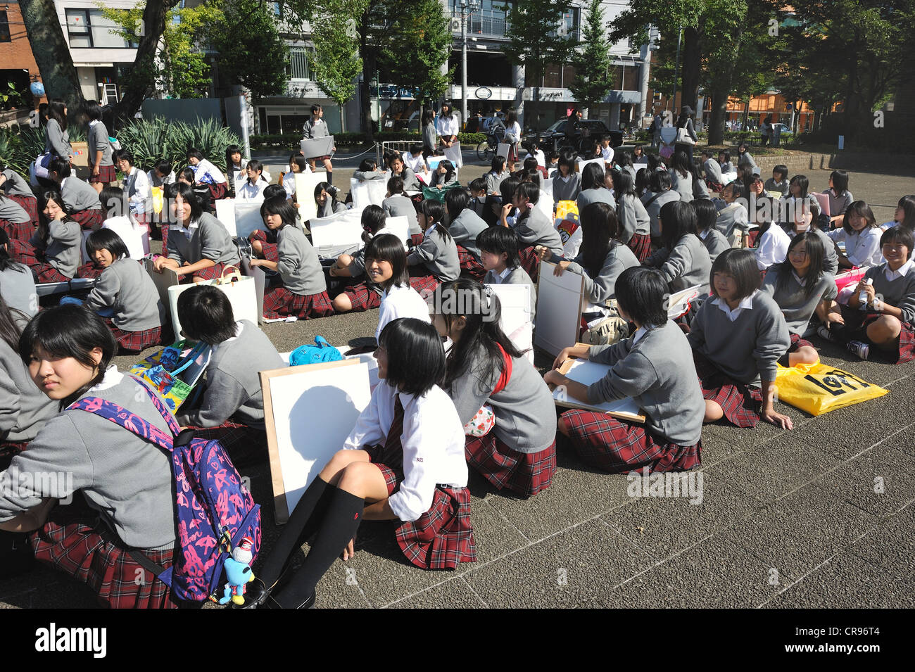 School children waiting in front of the Botanical Garden before entering and spending the whole day drawing plants, - Stock Image