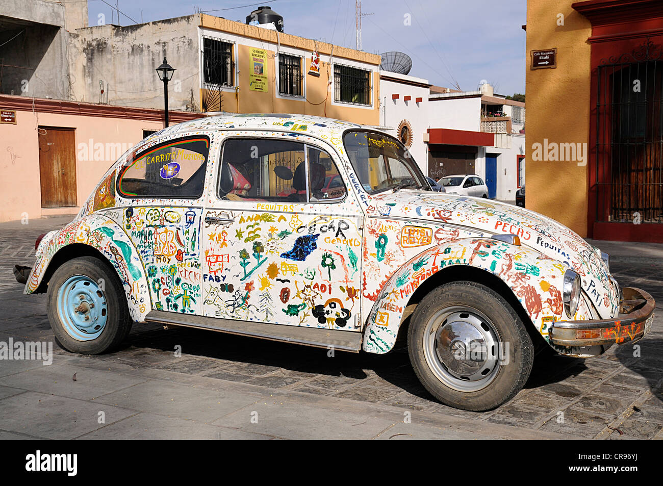 VW beetle decorated with graffiti, Oaxaca de Juárez, Oaxaca, southern Mexico, North America - Stock Image