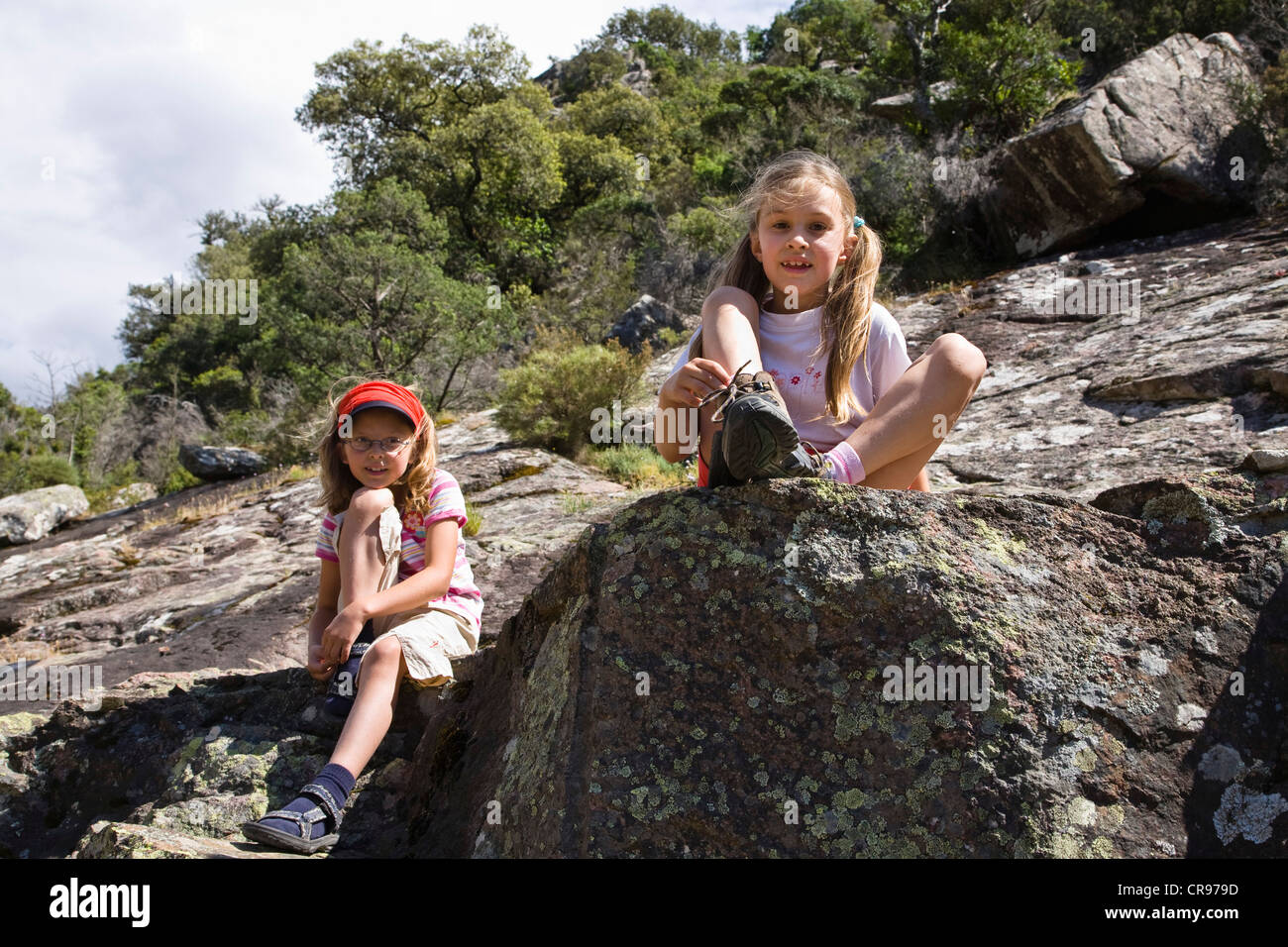 7-year-old girls in the valley of Figarella river, Foret de Bonifatu, Corsica, France, Europe - Stock Image