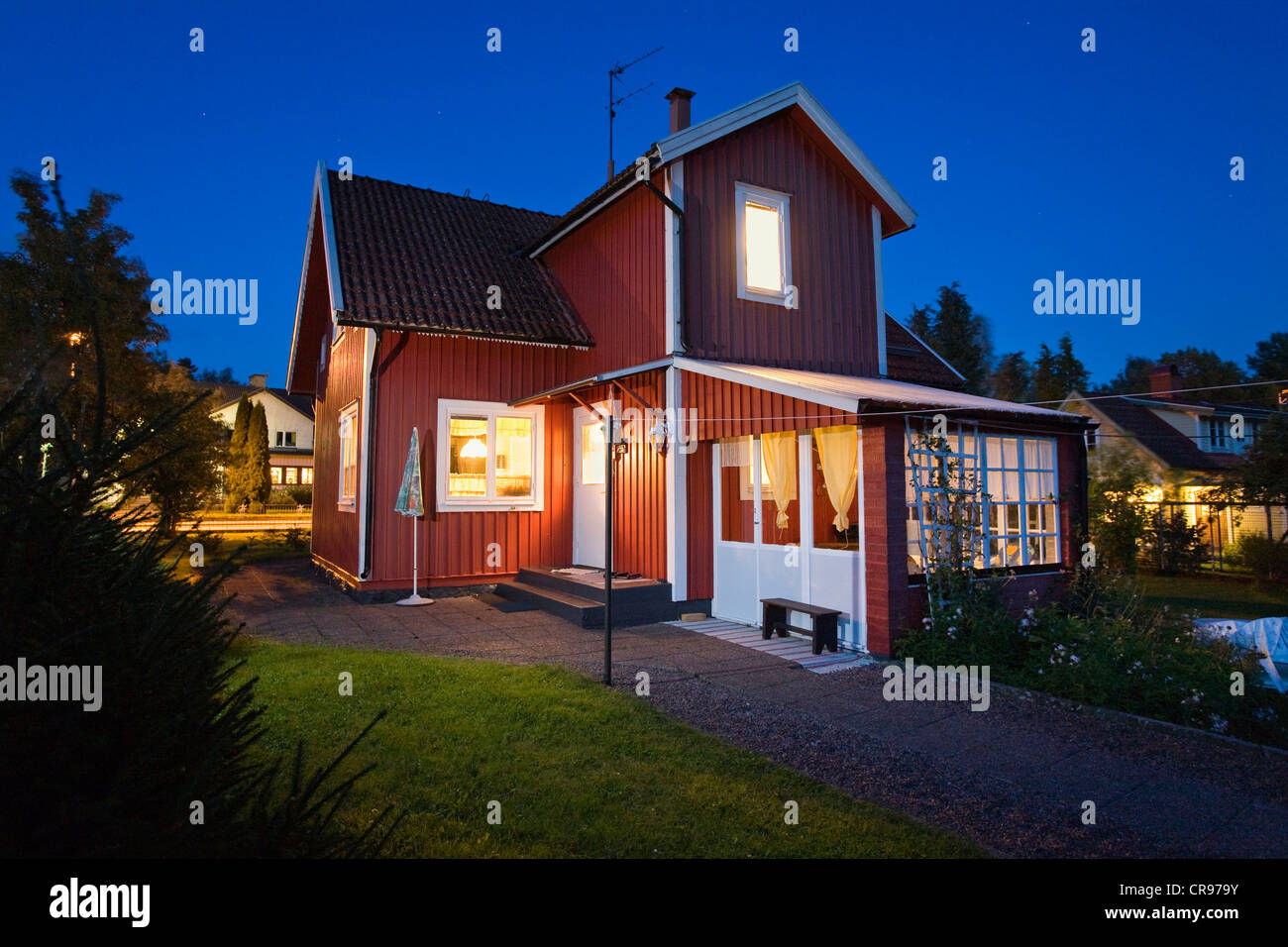 Typical swedish house at dusk in Alsterbro, blue hour, Smaland, South Sweden, Scandinavia, Europe - Stock Image