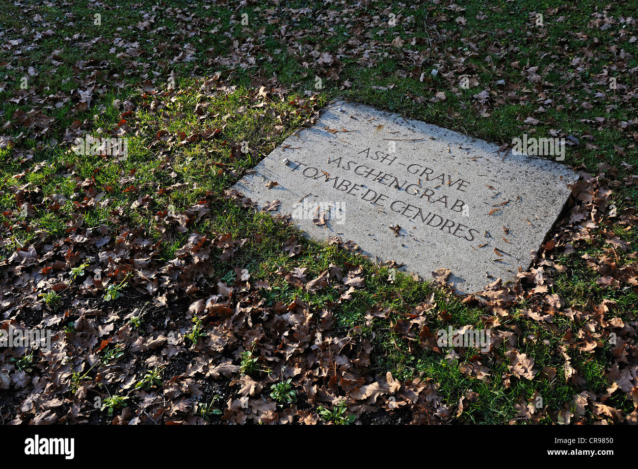 Memorial stone at the cremated remains of thousands of unknown prisoners, concentration camp, Dachau near Munich, - Stock Image