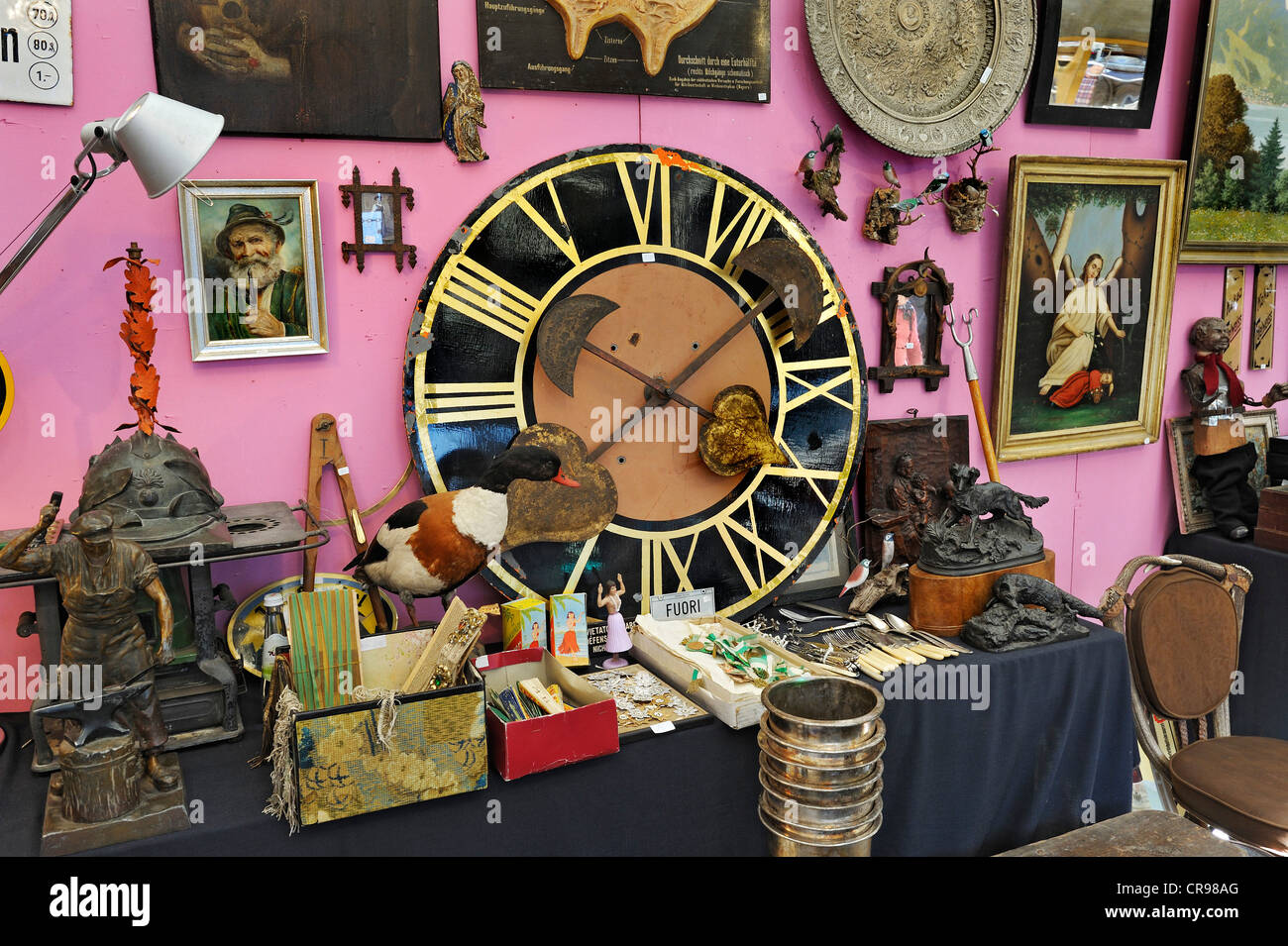 Large clock face and junk, Auer Dult market, Munich, Bavaria, Germany, Europe - Stock Image