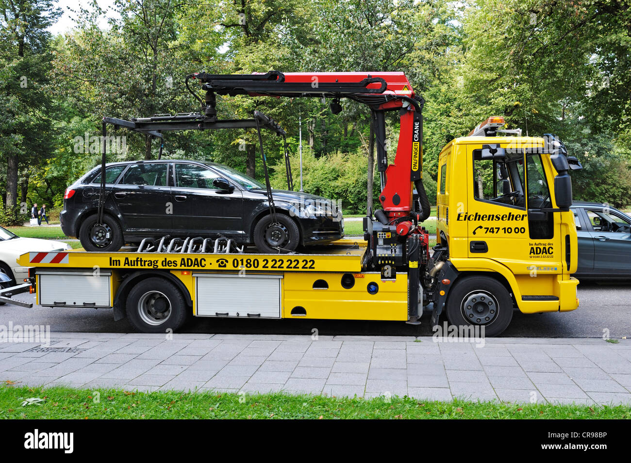 Car on a tow truck, Munich, Bavaria, Germany, Europe - Stock Image
