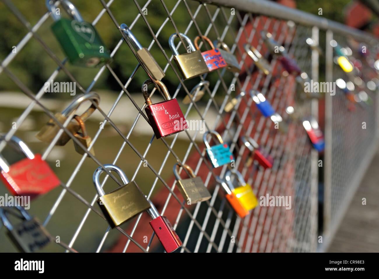 Love padlocks on Thalkirchner Bruecke bridge, Munich, Bavaria, Germany, Europe - Stock Image