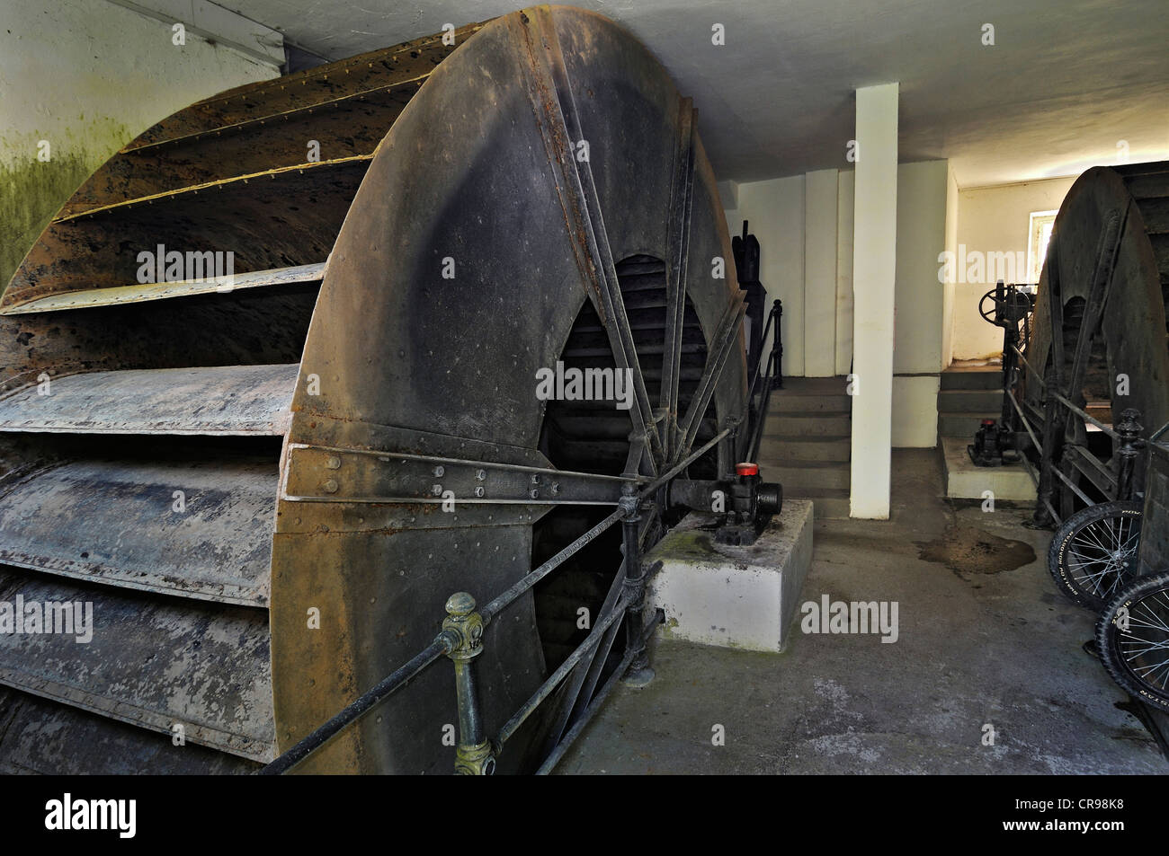 Paddle wheels, baroque pumping station in the Gruenes Brunnenhaus well house, Nymphenburg Park, Munich, Bavaria, - Stock Image