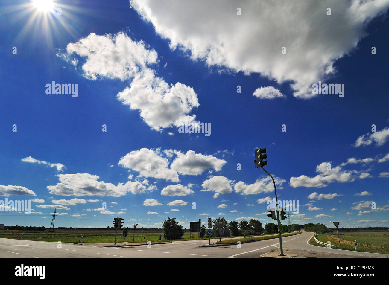 Blue sky with fleecy clouds and traffic lights, Garching near Munich, Bavaria, Germany, Europe - Stock Image