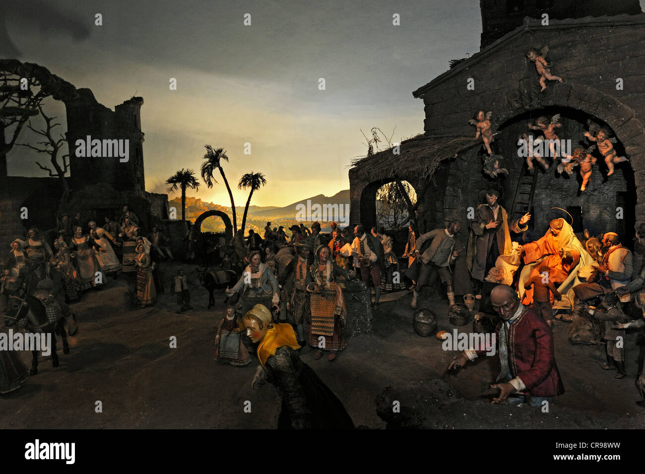 Crib collection, Adoration of the shepherds and the people in the Gulf of Naples, overlooking Mount Vesuvius in - Stock Image