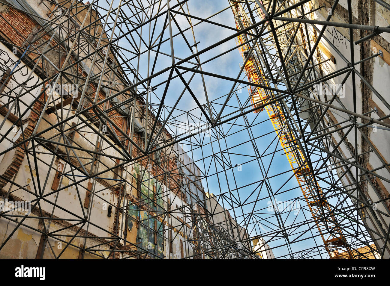 Scaffolding and building crane, Munich, Bavaria, Germany, Europe - Stock Image