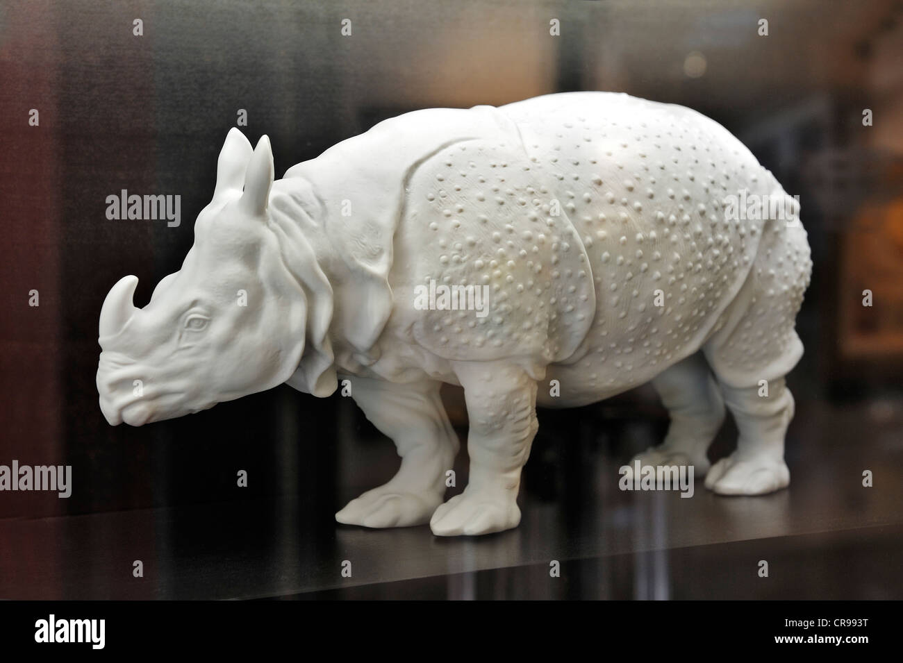 Indian rhinoceros made of porcelain in a showcase - Stock Image