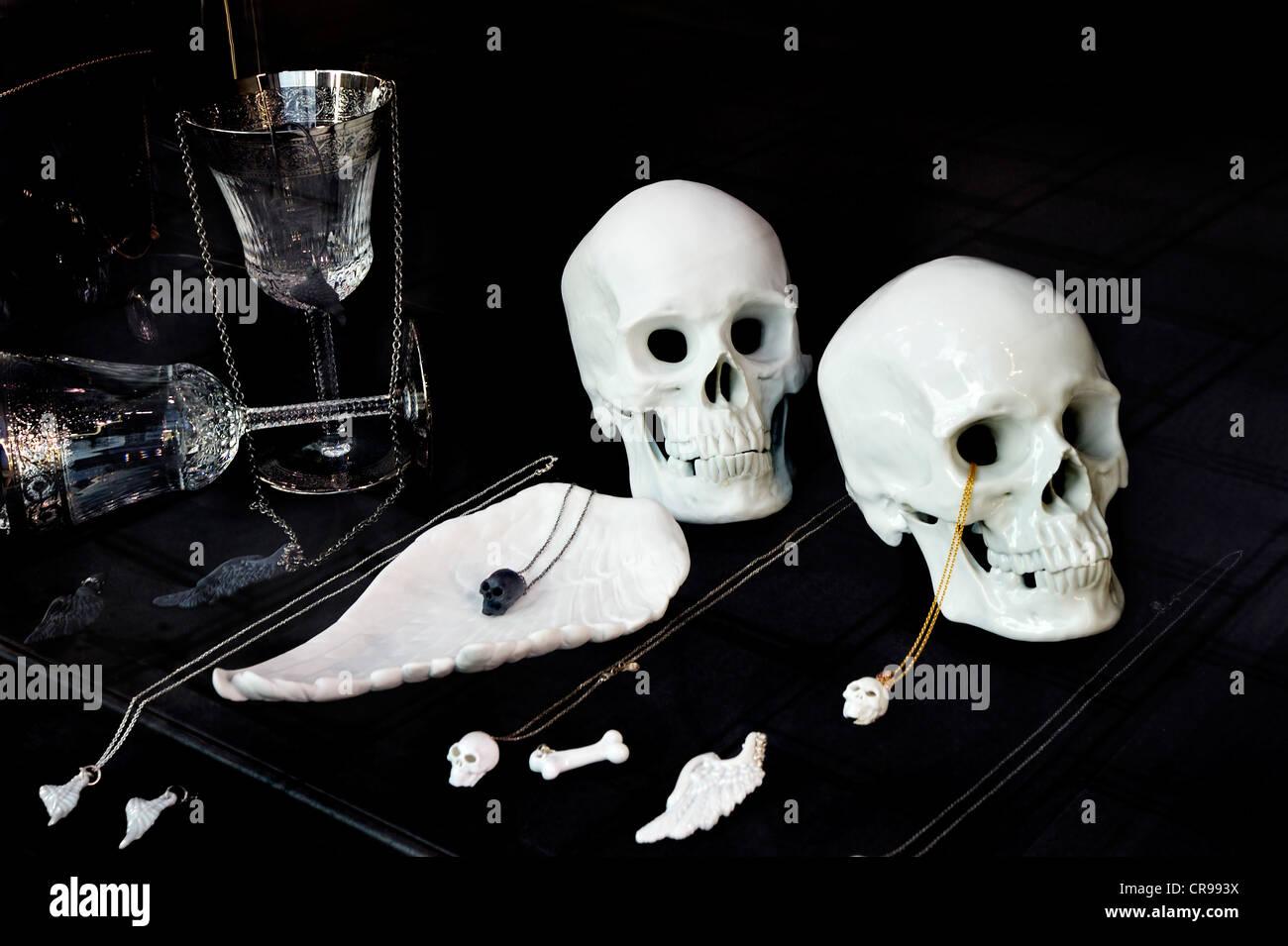 Showcase of jewellery with porcelain skulls - Stock Image
