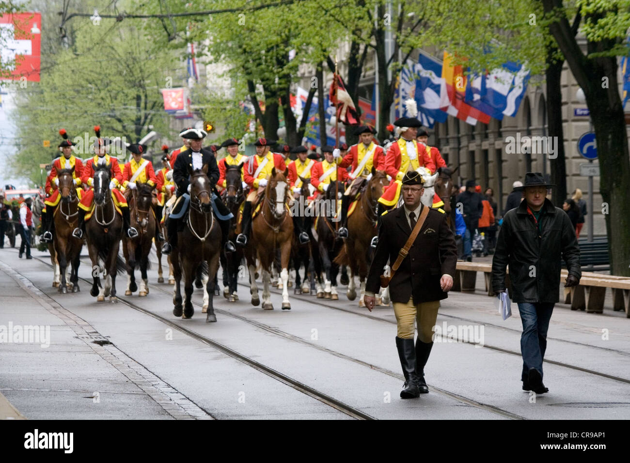 ZURICH - APRIL 16: Members of traditional annual spring parade of Guilds, ride along Bahnhofstrasse - Stock Image