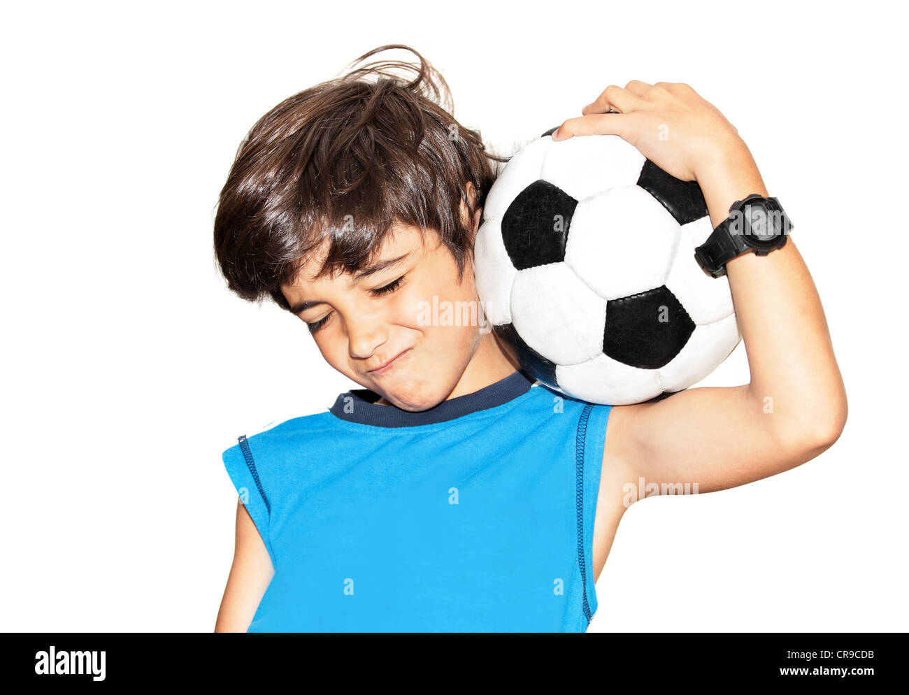Football player celebrating victory, cute little boy playing, kid enjoying team game, teen holding catching ball, - Stock Image