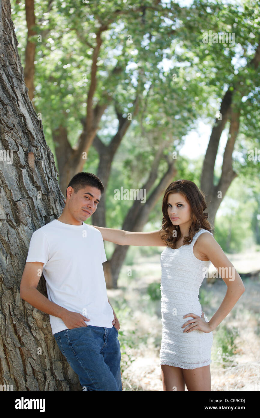Young couple having communication issues outside in the woods - Stock Image