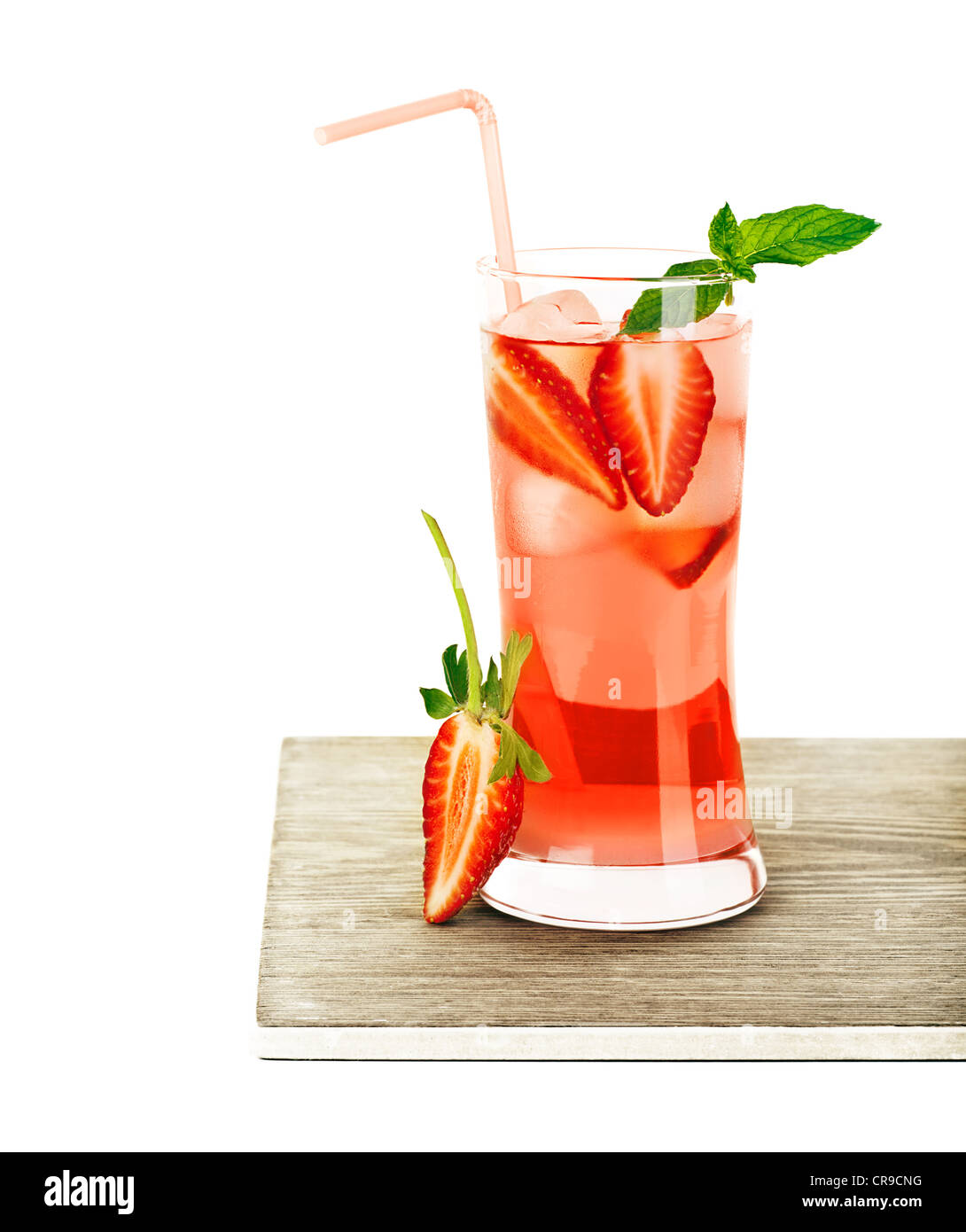 Red fruity strawberry cocktail with mint, cold drink isolated over white background, refreshing summer beverage - Stock Image
