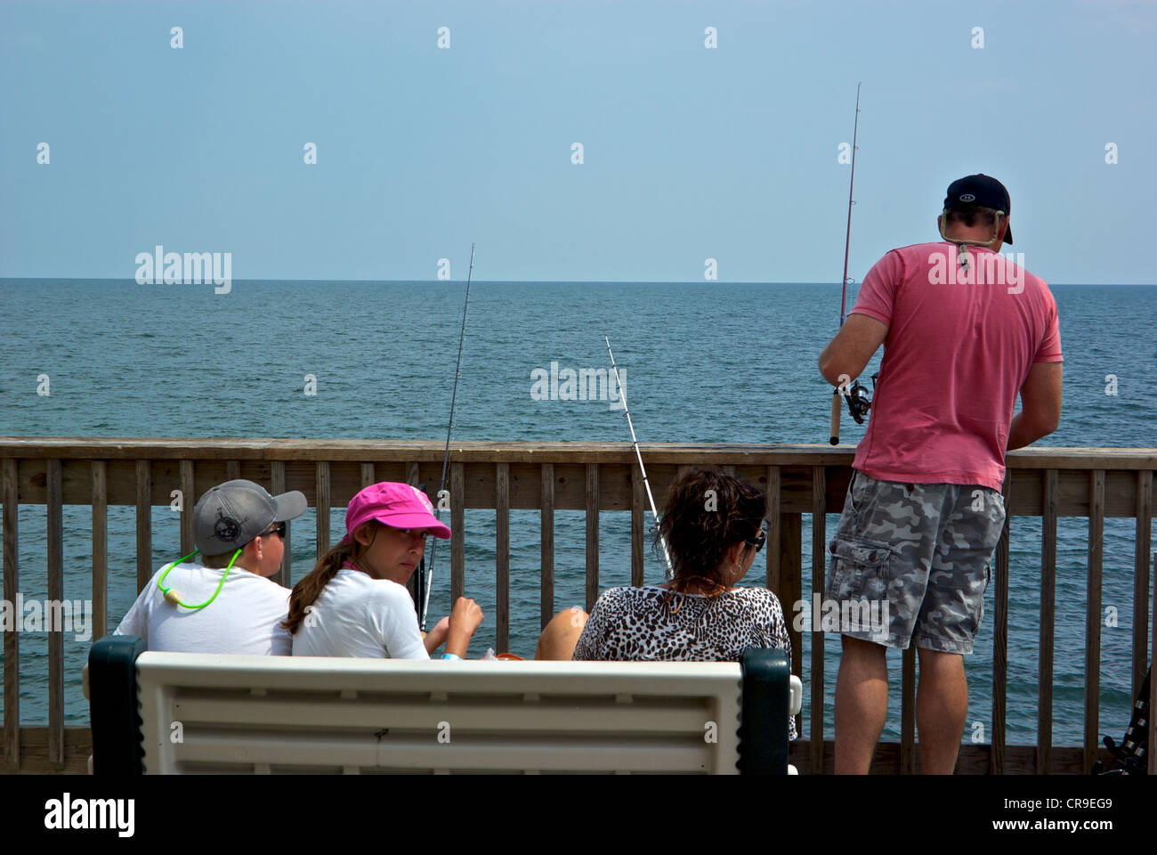 Family angling Gulf Shores Alabama State Park saltwater fishing pier Stock Photo