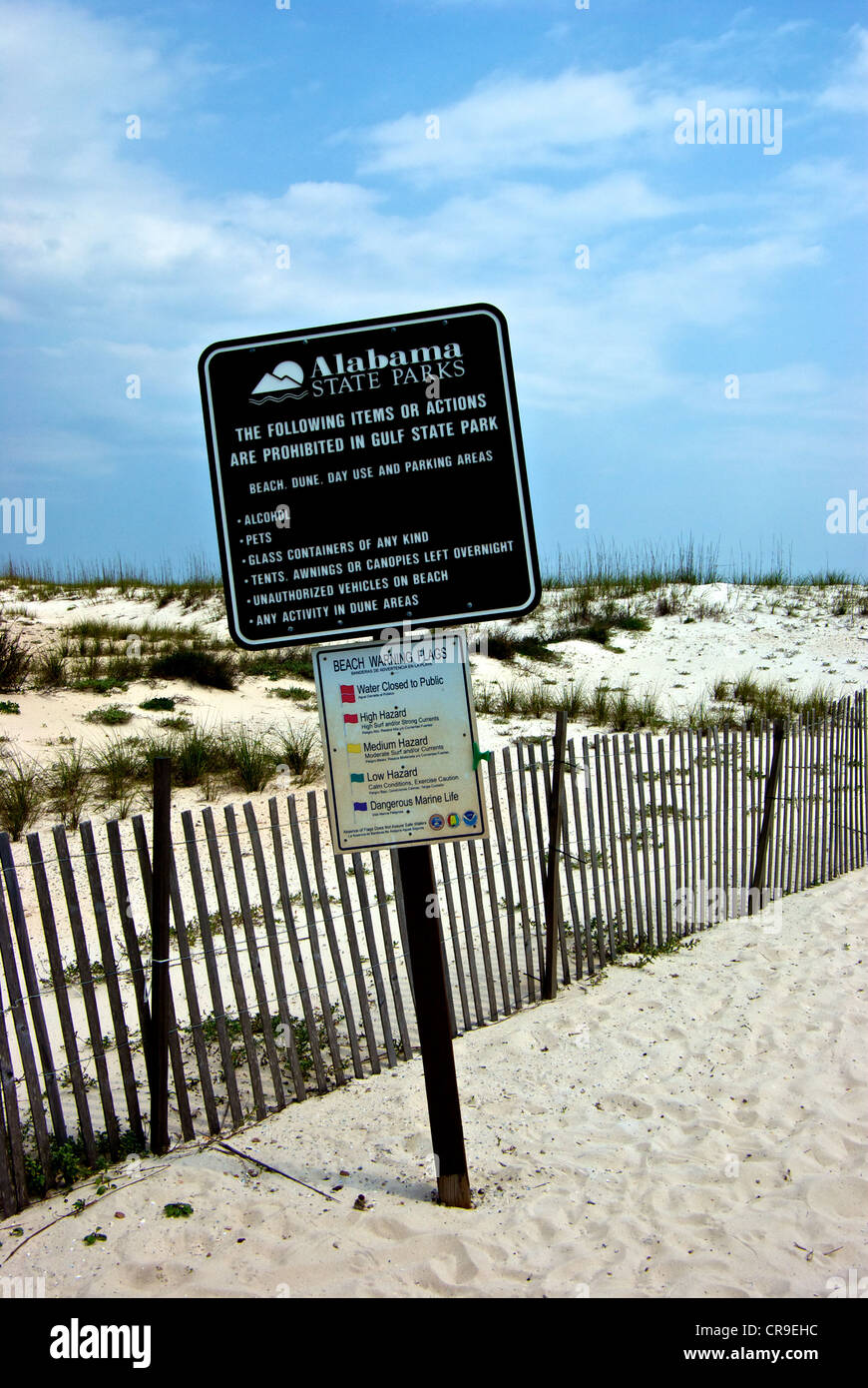 Gulf Shores Alabama State Parks beach dune day use parking rules sign sea condition warning flags Stock Photo