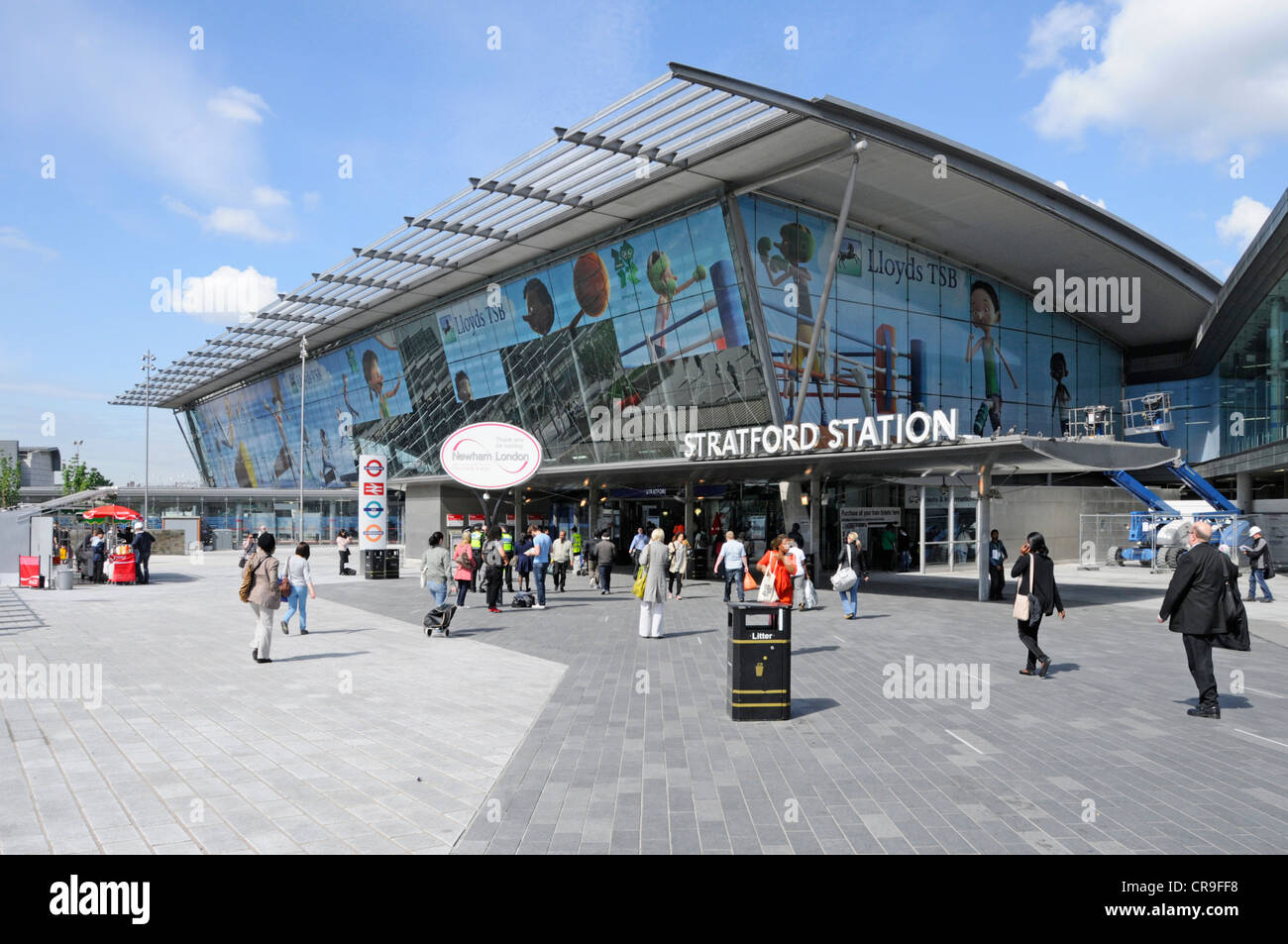 Stratford railway station & concourse with Lloyds TSB Olympic sponsors advertising panels on windows nearing - Stock Image