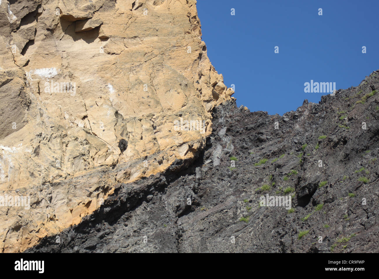 Contrasting rock formations set against blue sky on Fernandina Galapagos islands Ecuador - Stock Image