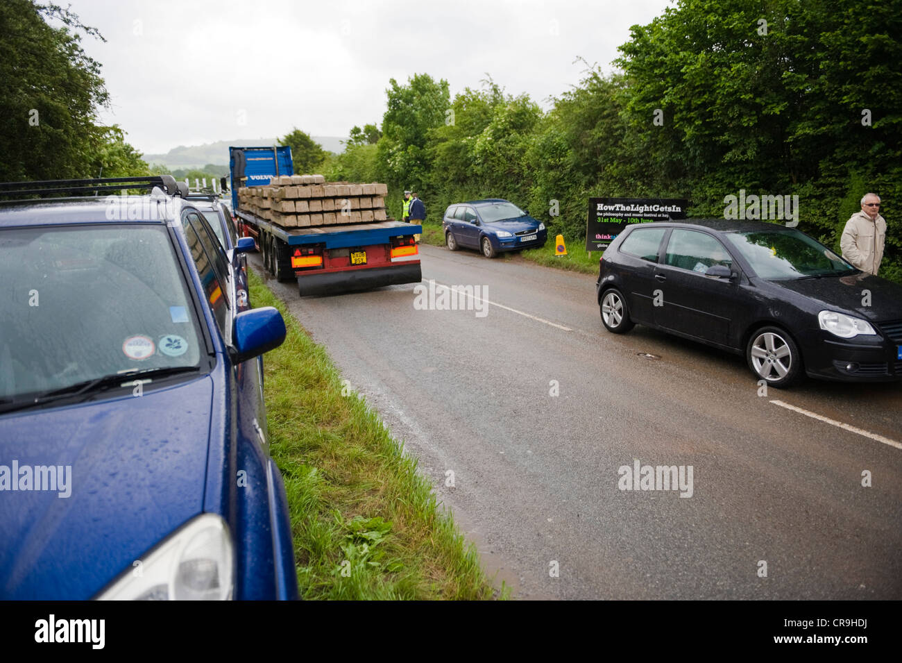 Drivers parked on roadside verge after car parks were closed due to bad weather at The Telegraph Hay Festival 2012, - Stock Image