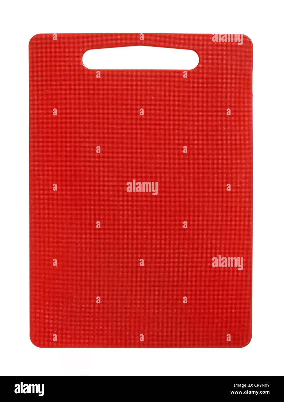 Orange/red cutting board - Stock Image