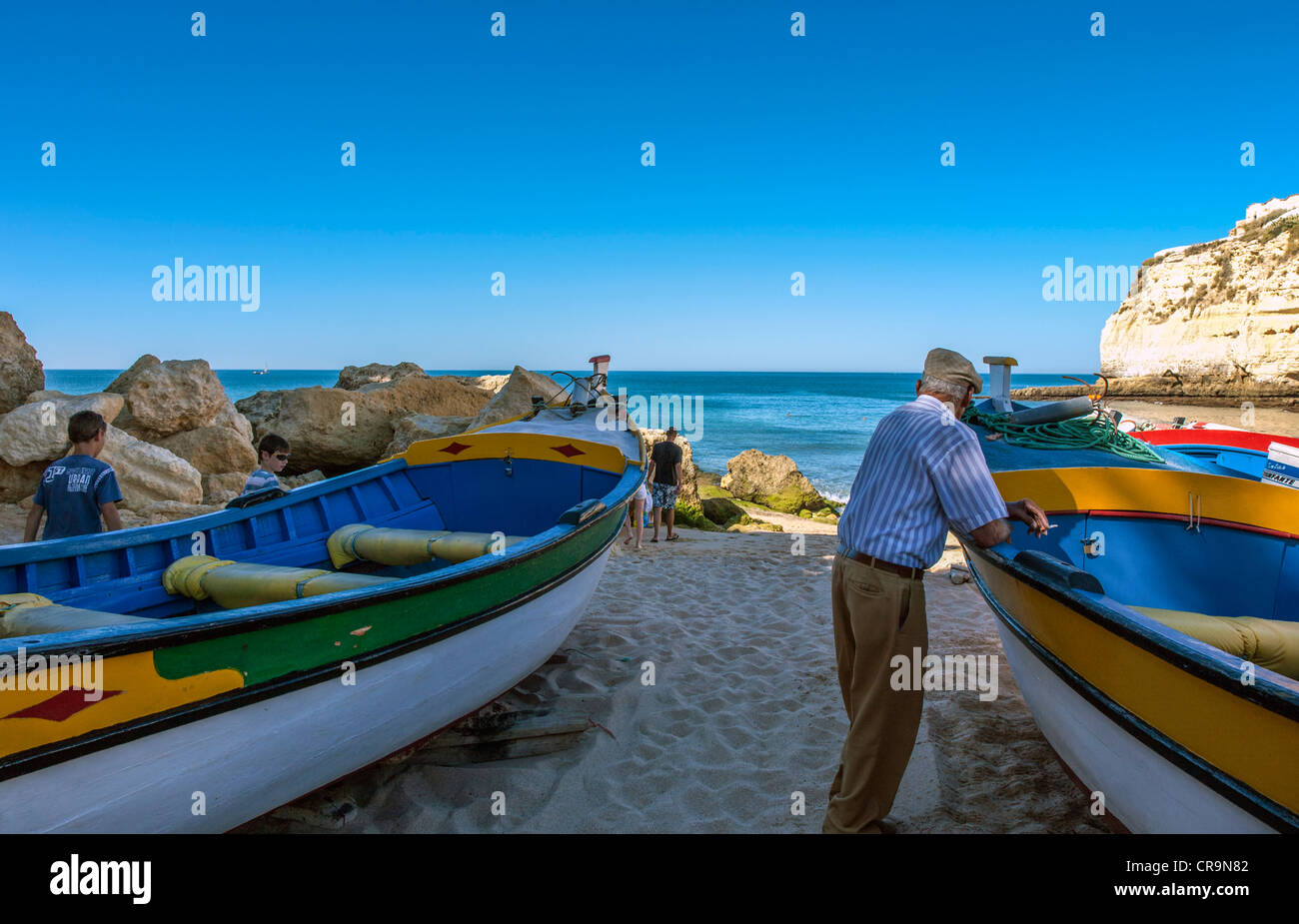 Portugal, Algarve, fishermen on the beach of Carvoeiro - Stock Image