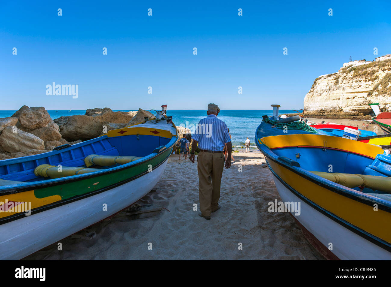 Europe Portugal, Algarve, fishermen on the beach of Carvoeiro - Stock Image