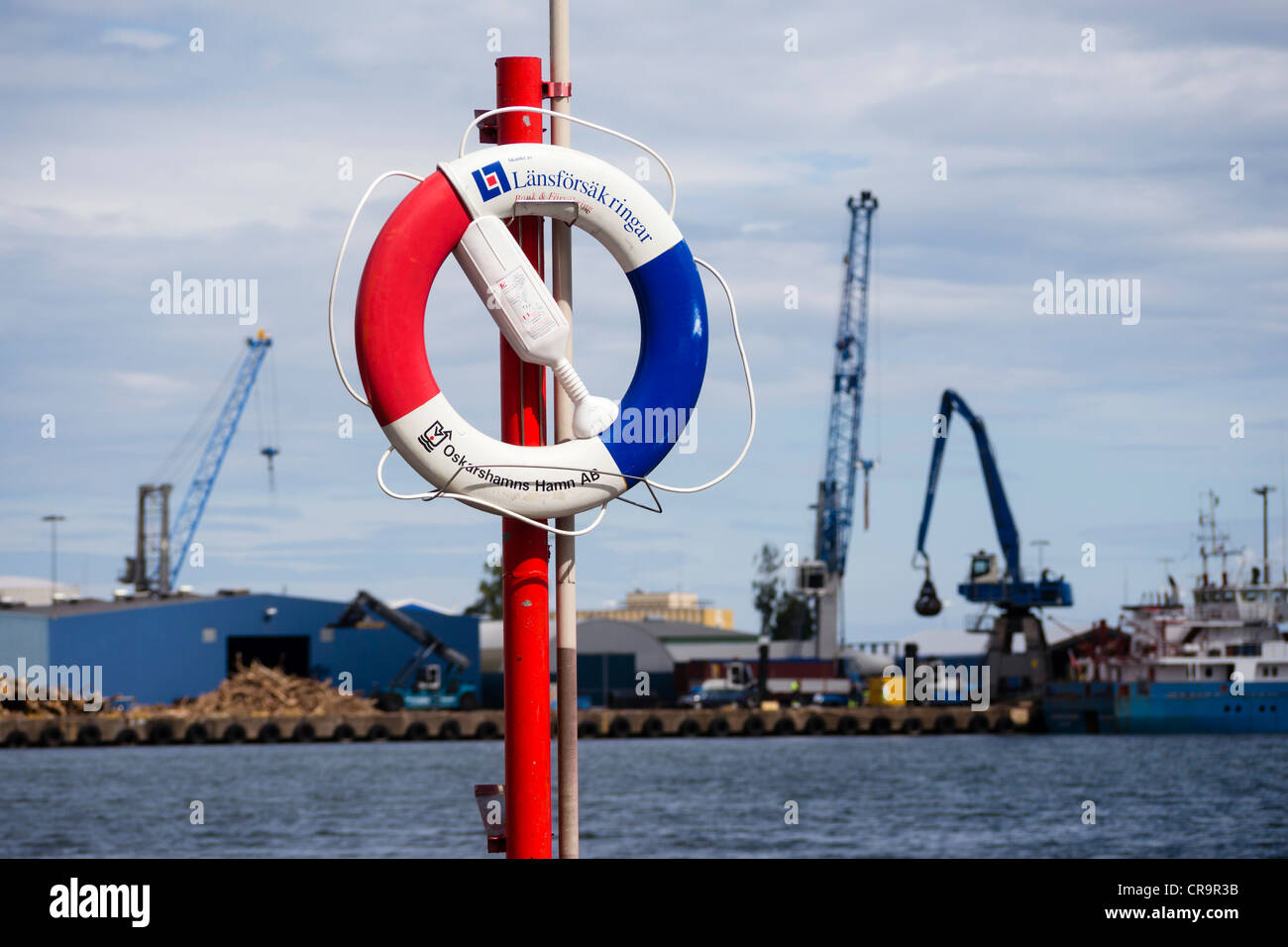 A lifebelt in the harbour of Oskarshamn. - Stock Image