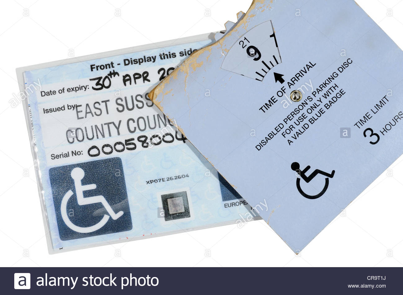 Disability Blue badge and parking clock, England - Stock Image