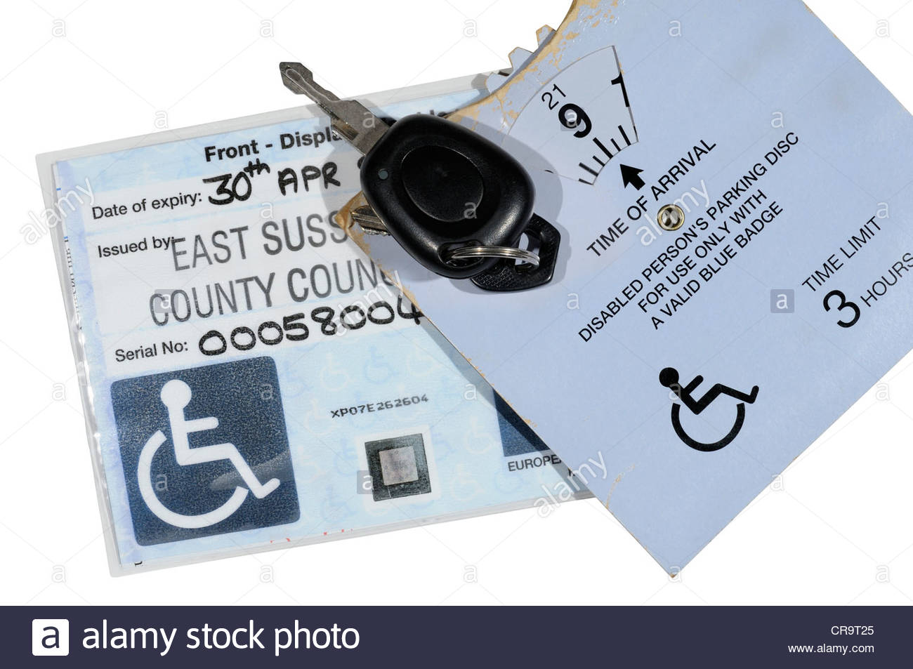 Disability Blue badge, parking clock and car keys, England - Stock Image