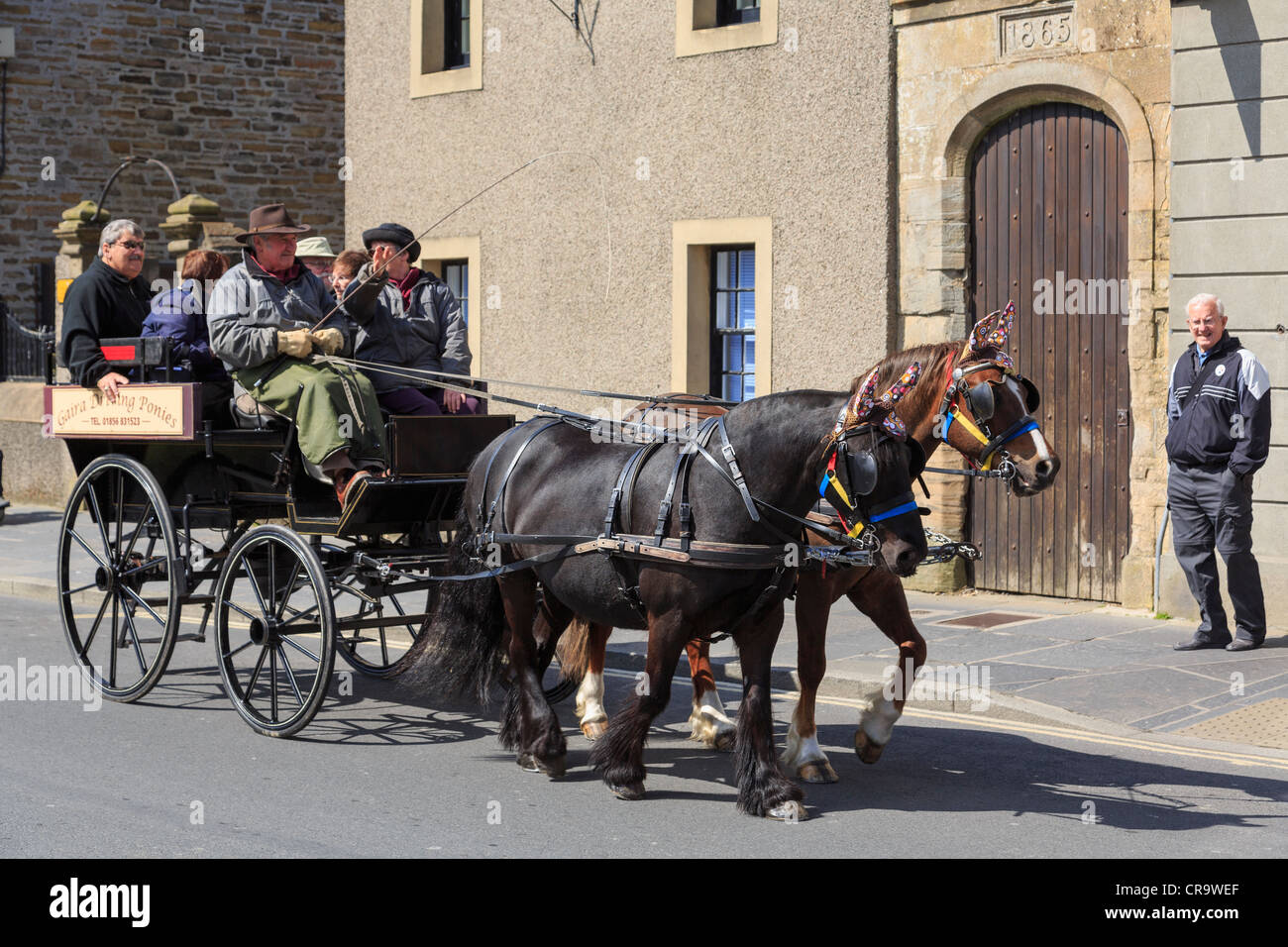 Tourists on a city tour by tourist horse and carriage in Kirkwall, Orkney Islands Mainland, Scotland, UK - Stock Image