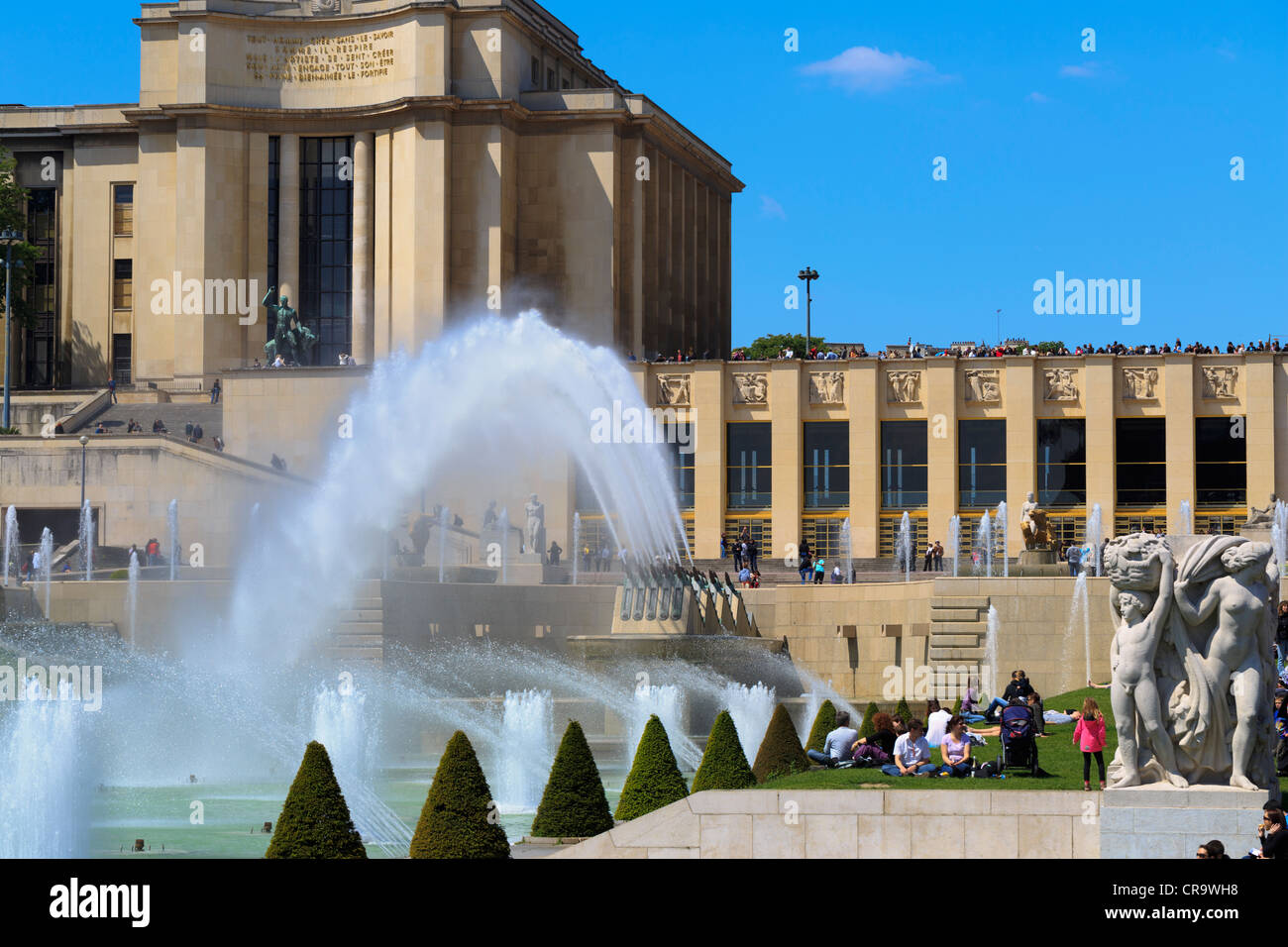 Water cannons at Trocadero Gardens, Paris. Museums of the Palais de Chaillot overlook the gardens with the Fountains - Stock Image