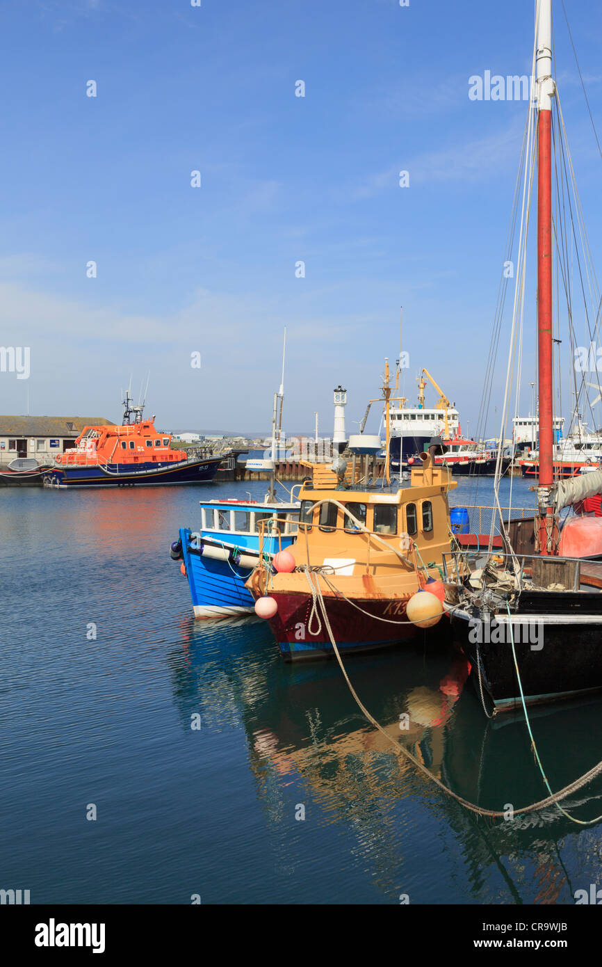 Fishing boats moored in the inner harbour with the lifeboat beyond in Kirkwall, Orkney Islands, Scotland, UK, Britain - Stock Image