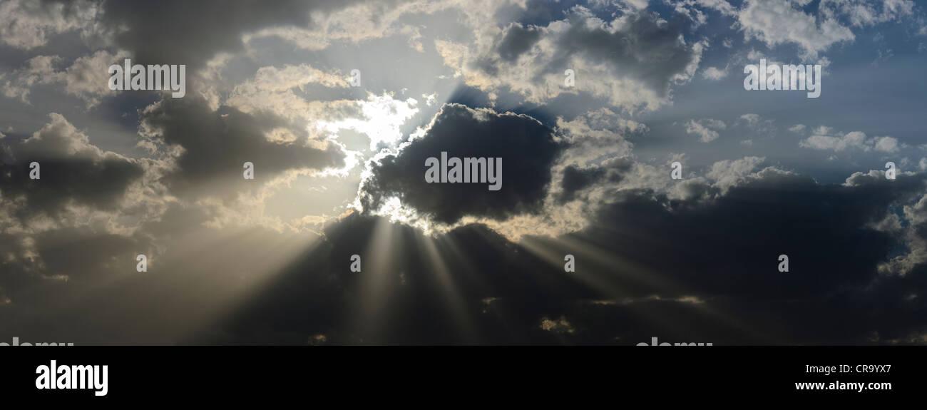 Sun through clouds Stock Photo