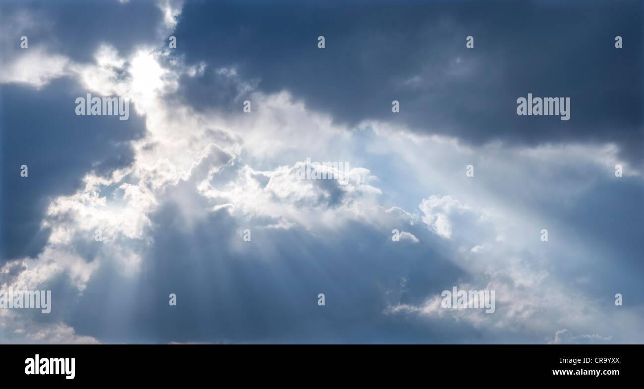 Sun through clouds - Stock Image
