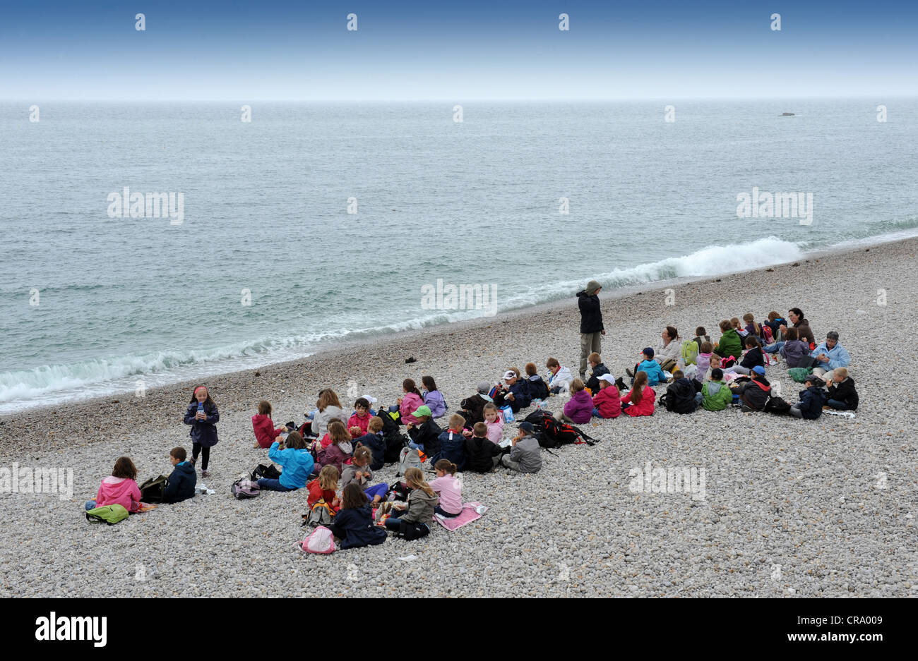 School children having lunch on the beach at Etretat Normandy France - Stock Image