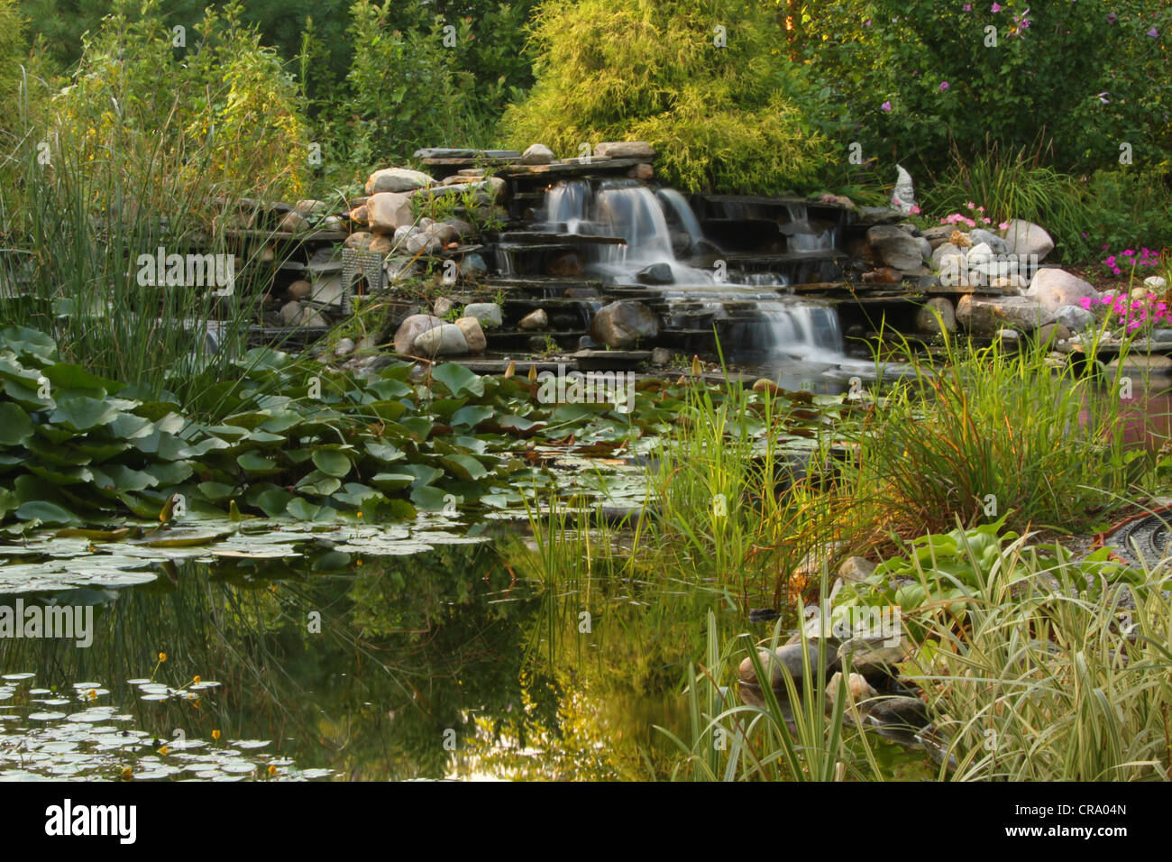 Backyard Water Garden with Waterfall. Scene from a back yard Water Garden and Garden Train in Centerville, Dayton, - Stock Image
