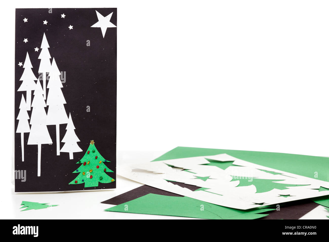 Construction paper, bag, and stencils to make Christmas gift bags ...