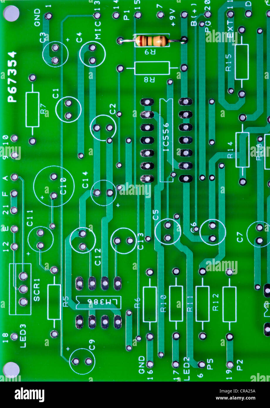PC Circuit board with a schematic printed on it with a single resistor in it - Stock Image