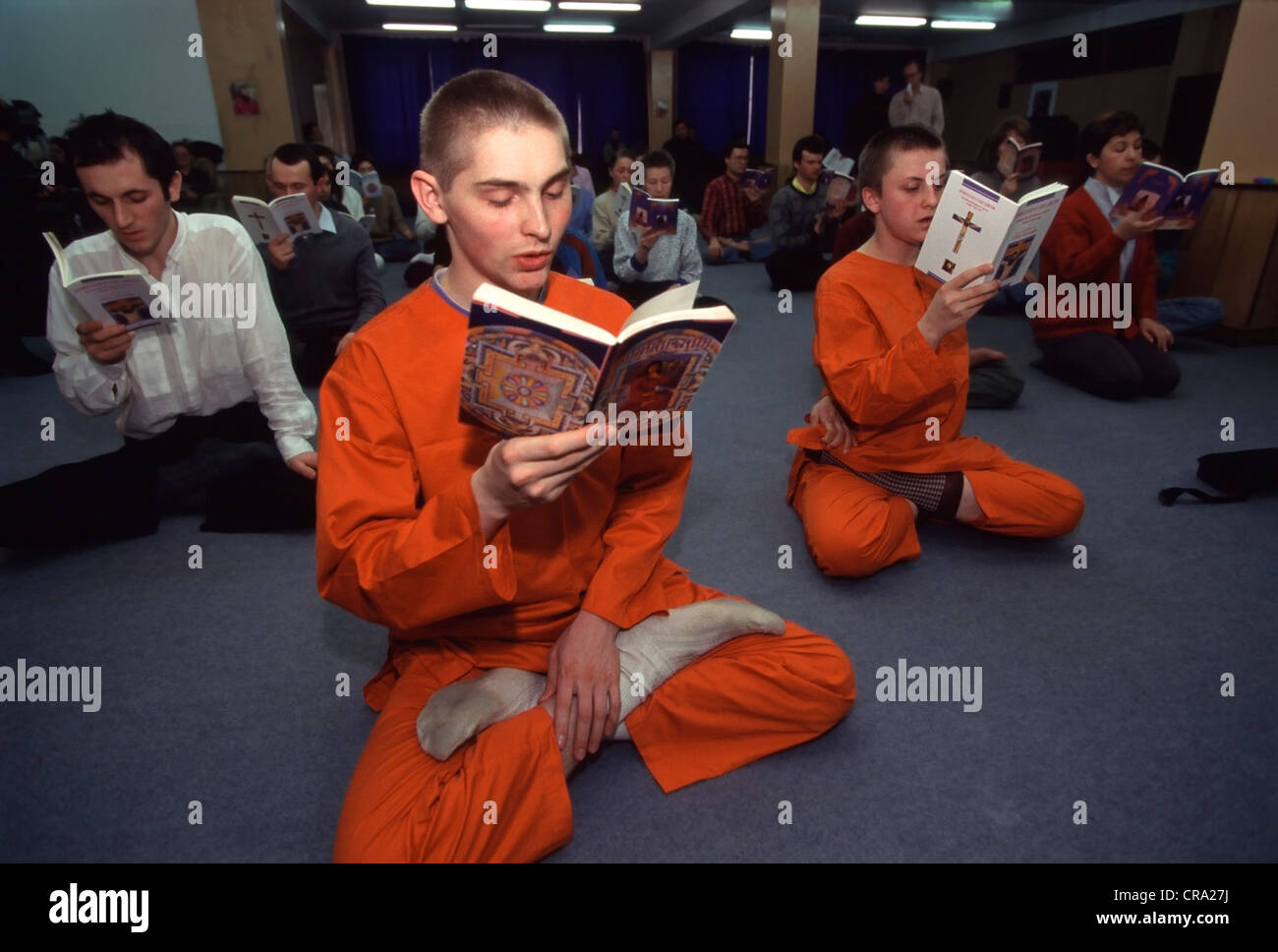 Russian disciples of the Japanese cult Aum Shinrikyo meditate in the Moscow office of the cult on March 24 1995 - Stock Image
